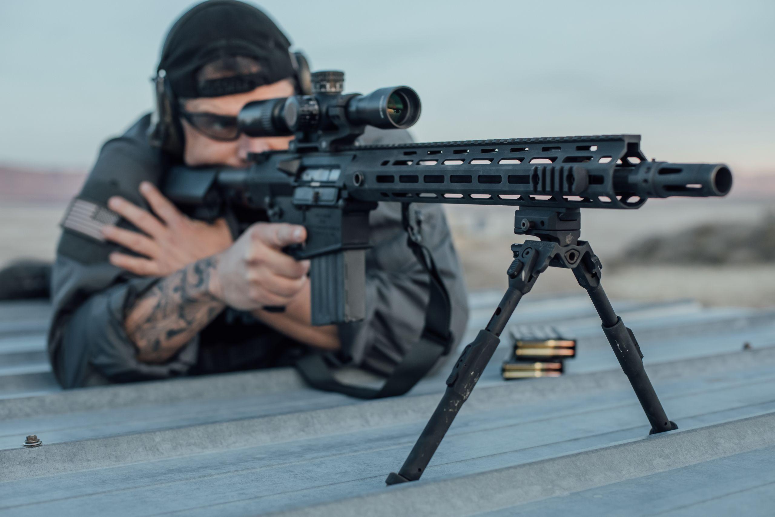 Knight's Armament Promo Image - Man Behind KAC Rifle